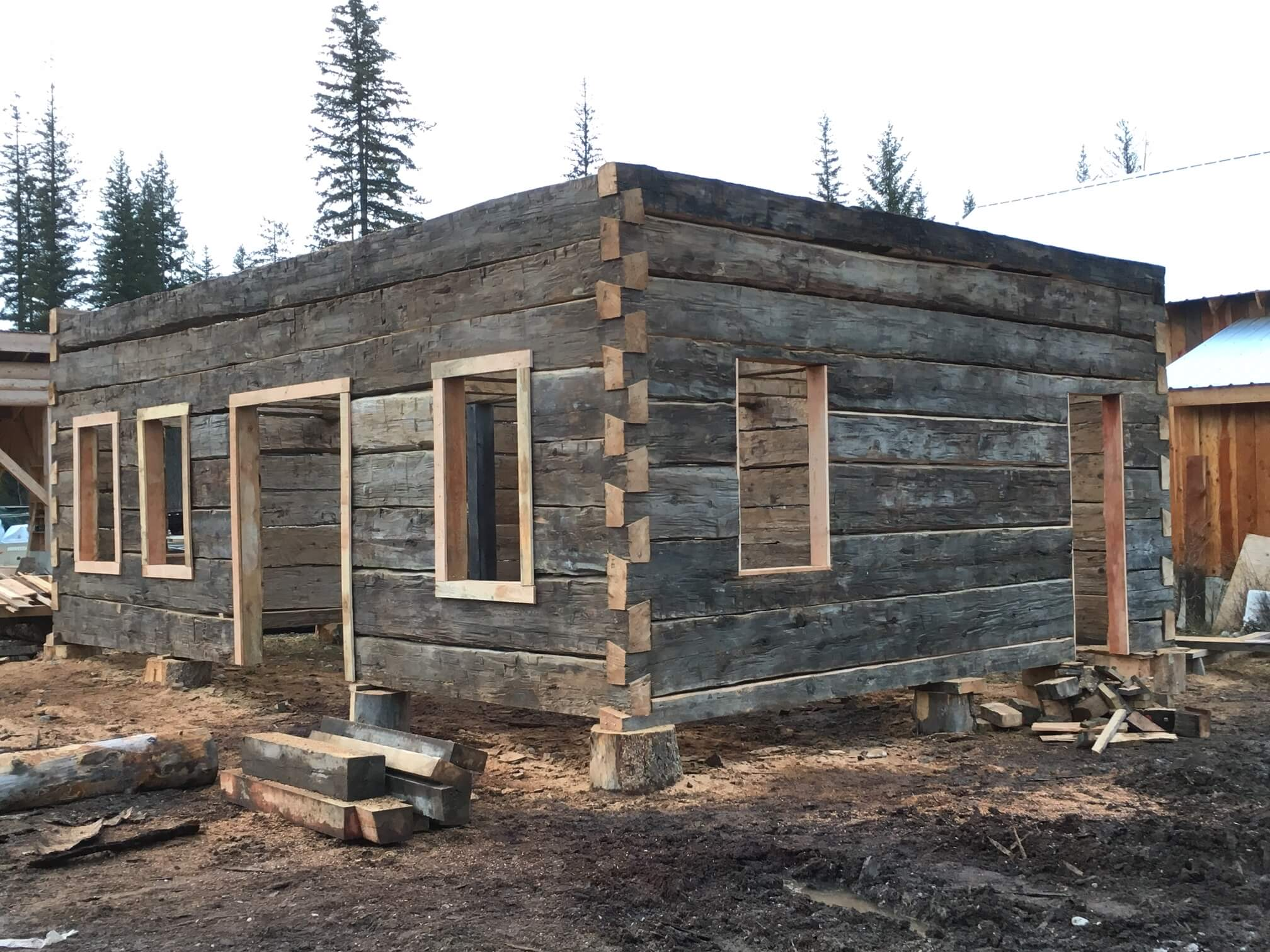 For sale hand hewn heritage log shell this building for Hewn log cabin kits